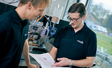 Matthias Straubhaar inside the Waterjet lab rating a feasability study